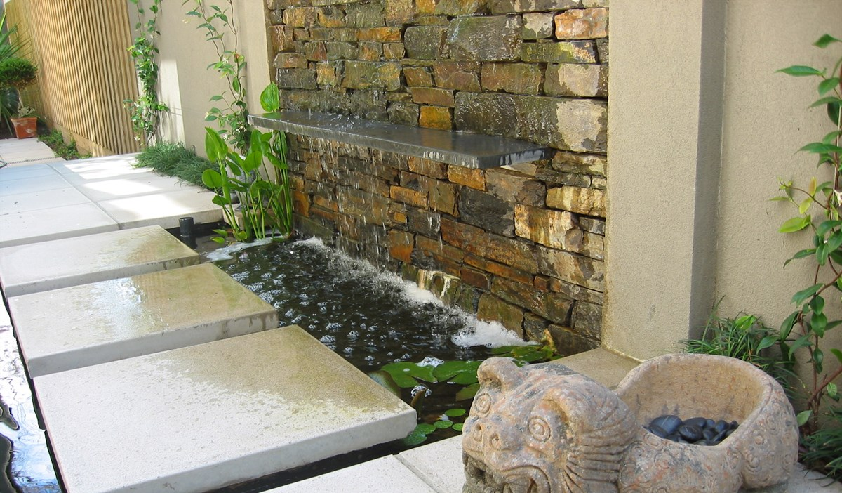 Stepping stones over waterfeature